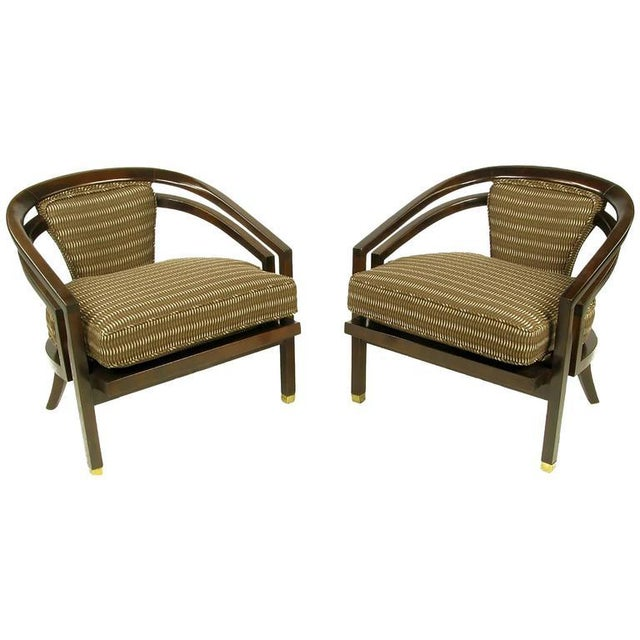 Elegant and sophisticated, this pair of art deco inspired club chairs, often misattributed to Harvey Probber, have been...