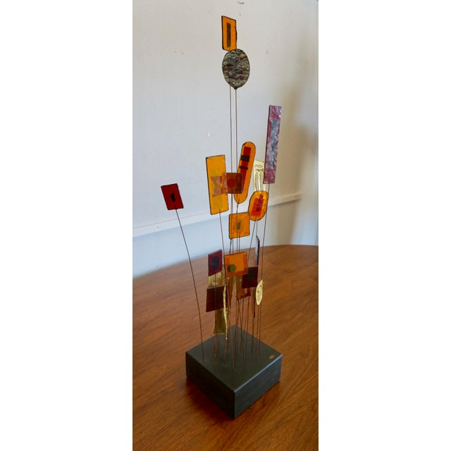 """Signed """"Jere"""" at the base. Colored resin framed in brass ,mounted with copper wire and set in a wood base."""