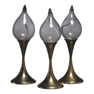 Set of three identical brass oil lamps or candle holders, Denmark