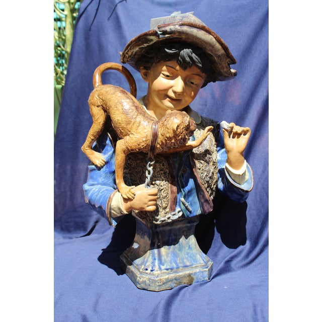 A figure with monkey. This piece is a very large, fantastic majolica. Made with earthenware clay.