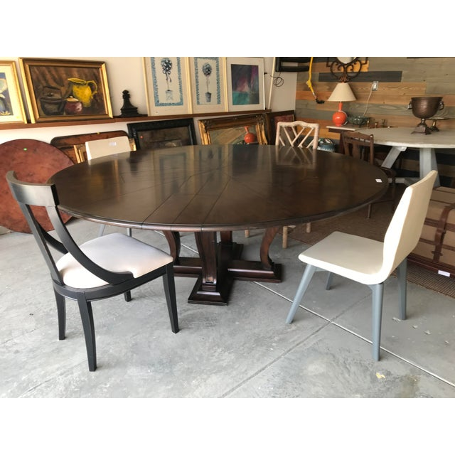 Soho Jupe dining table large solid walnut with a dark walnut finish 64 inch diameter when closed 84 inch diameter when...