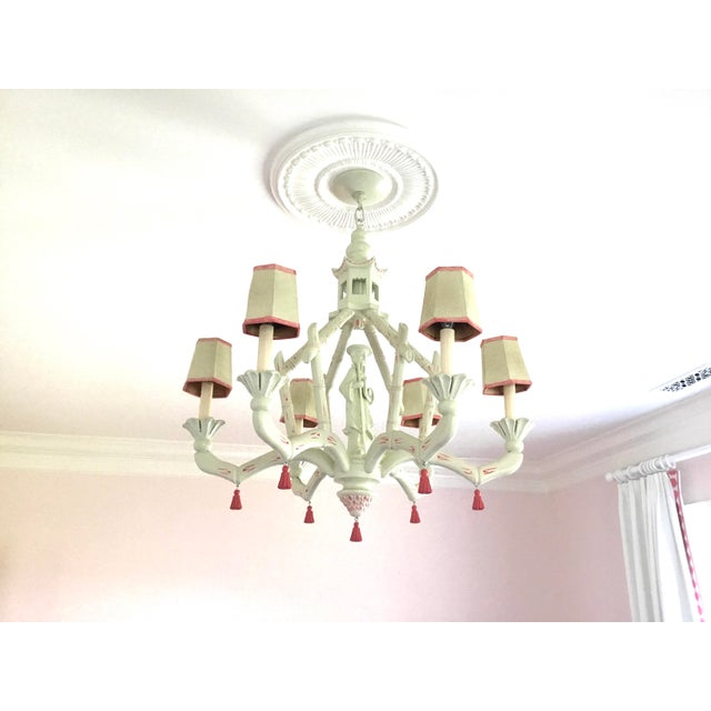 6-arm Chinoiserie Chandelier. Hand painted with pink trim highlights. Paint has been restored to fixture. Lampshades are...