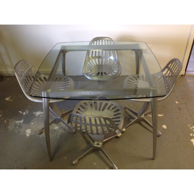 Azcast aluminum dining set with glass top and tractor seat chairs. All Azcast products are made from recycled aluminum....