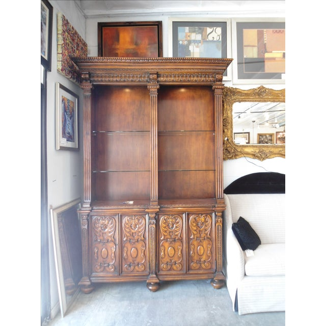 Solid wood Arte de Mexico tall bookcase with cabinets on bottom. With glass shelves.