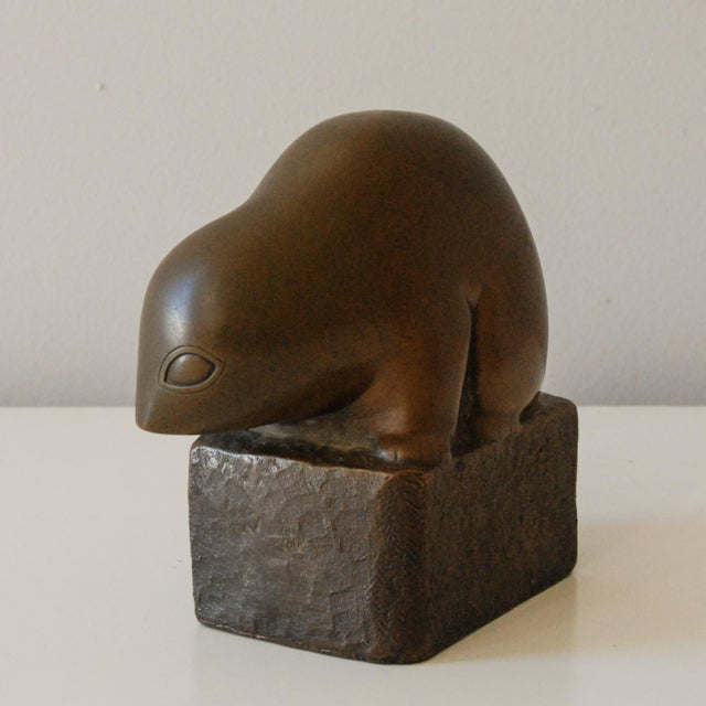 A very stylized copper over plaster sculpture of a lemur by noted sculptor Marian Weisberg. The work is signed on the side...