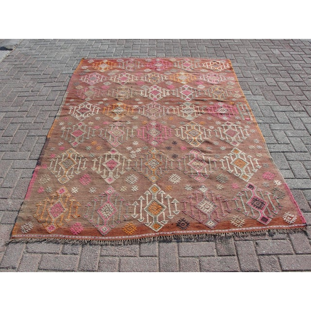 This is a vintage handwoven Turkish kilim rug. The kilim is nearly 65 years old. It is handmade of very fine quality...