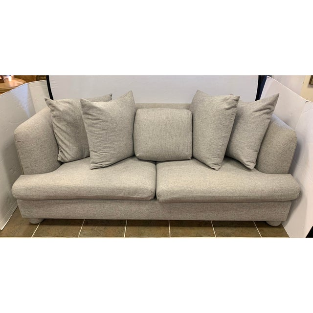 Stunning, large three-seat Donghia sofa designed by famed designer John Hutton. Upholstered in a soft wool blend fabric....