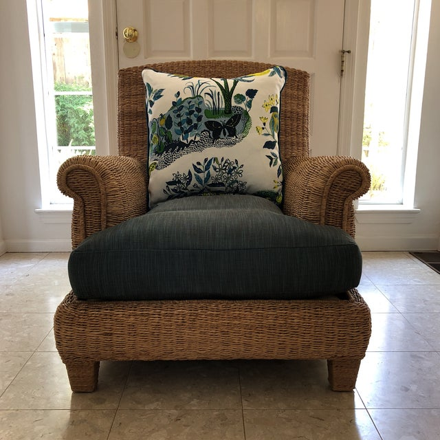 This Ralph Lauren Herring Net wicker chair is deep and comfortable for lounging. It has an upholstered seat cushion in an...