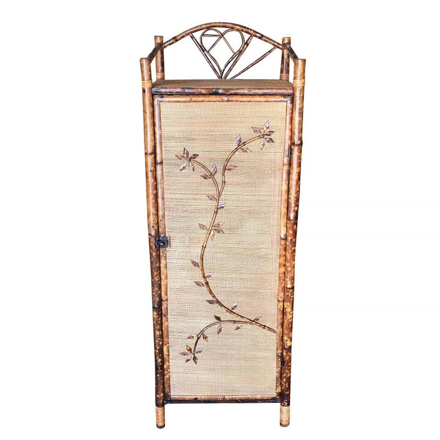 Antique single door tiger bamboo linen cabinet with rice mat covering and four shelves inside. Restored to new for you....