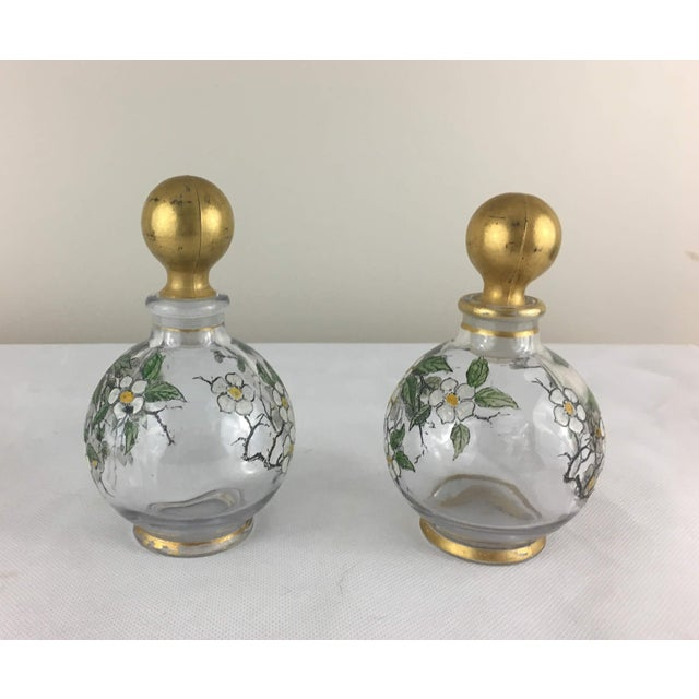From the estate of a collector of fine French antiques, this pair of bottles/cruets are heavy glass with hand-painted...