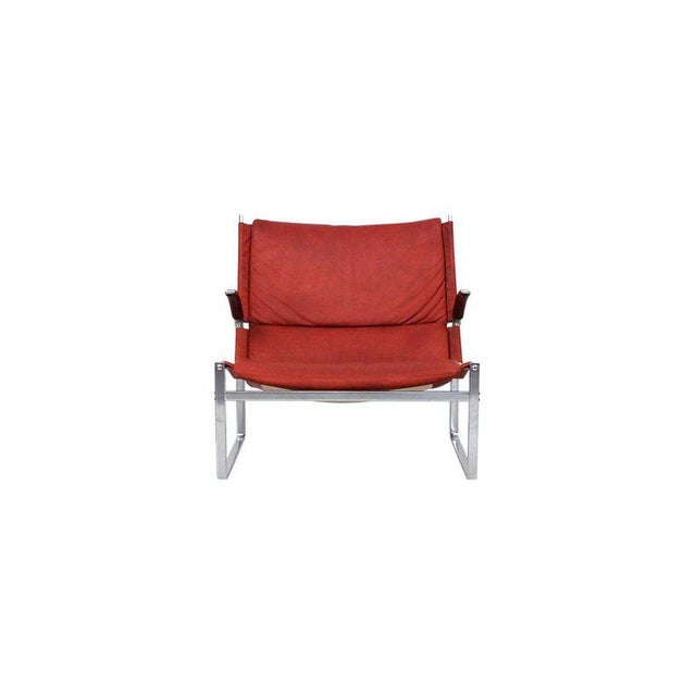 Rare Fabricius and Kastholm lounge chair and ottoman. Original ox blood leather and steel frame. Design for Alfred Kill...