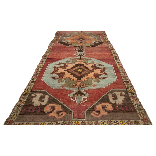Handknotted vintage rug from Kars region of Turkey. Approximately 55-65 years old. In very good condition