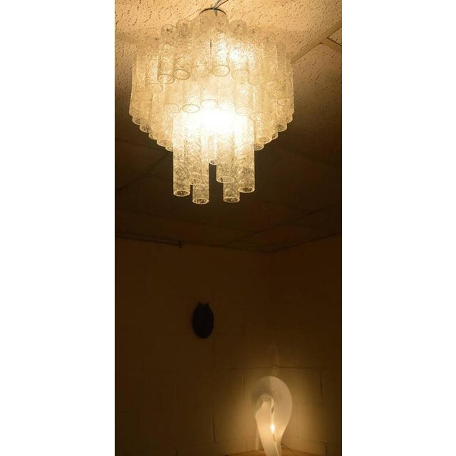 Very sympathetic Doria chandelier in three layers. The unusual thing about this chandelier is that the third layer has two...