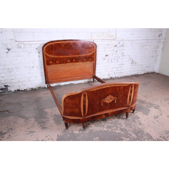 A gorgeous original 1930s French Art Deco bow front full size bed frame. The bed features stunning burl wood grain and...