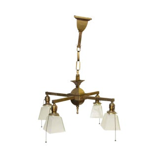 Four Arm Brass Chandelier With White Glass Shades For Sale