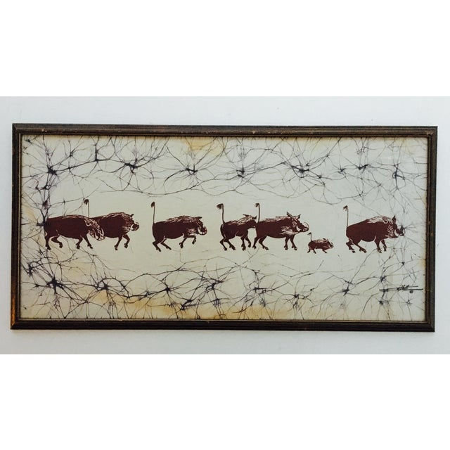 Get your safari man cave groove on with this gorgeous vintage rendering of a pack of boar rambling on in the plains...