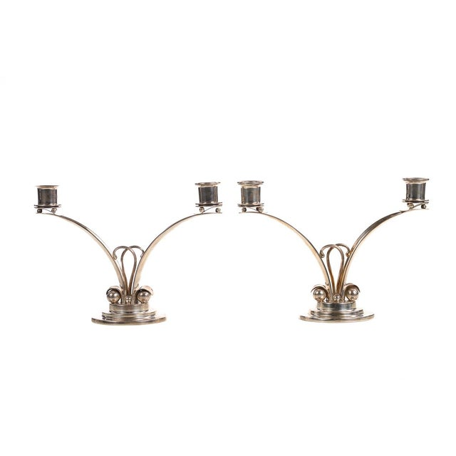 Pair of sterling 925 Modern designer candlesticks. Each holds two candles. A stunning pair for a dining room display.