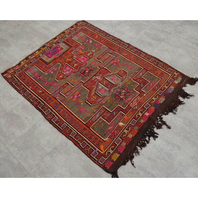 Material of this rug is wool on wool. The condition is very good. It has been newly washed and is ready to use. Rug is not...