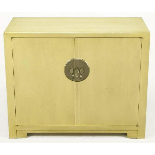 Pair of Baker Asian inspired two door cabinets, from Winsor White's Far East Collection. One cabinet features three...