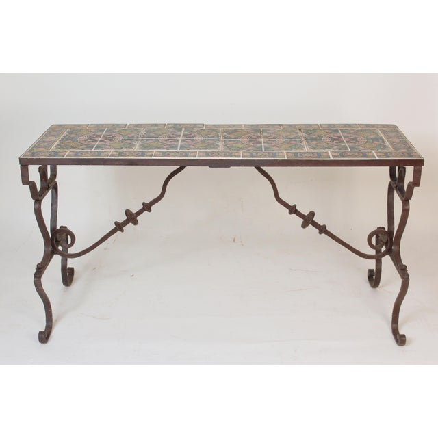 Wrought iron patio / library table / console table with Spanish tiles on the top, made circa 1930-1950. The base is...