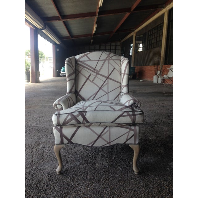 An absolutely stunning vintage wingback chair with fresh style in the form of abstract fabric and white washed legs. This...