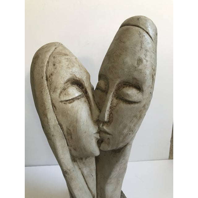 Vintage, modernist-style cast of entwined couple kissing. Extremely heavy piece.