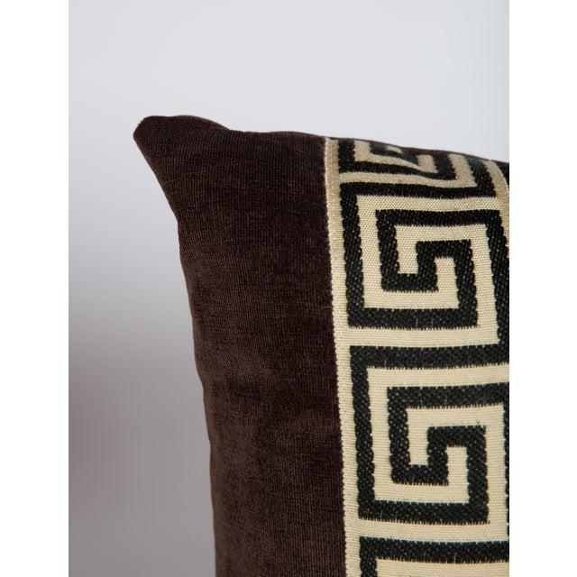 Eggplant velvet lumbar pillow with black and ivory Greek key tape on front. Solid velvet back, plump down insert, hidden...
