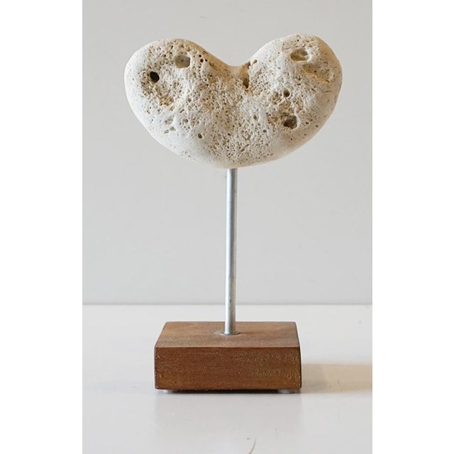 Handmade sculpture crafted in 2016 and put on a wooden base marked with ink. The heart is sculpted from a natural...