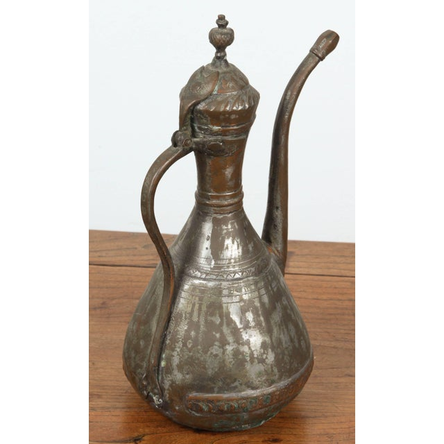 Middle Eastern Persian tinned copper ewer. Nice decorative hand-hammered ewer, great antique patina.