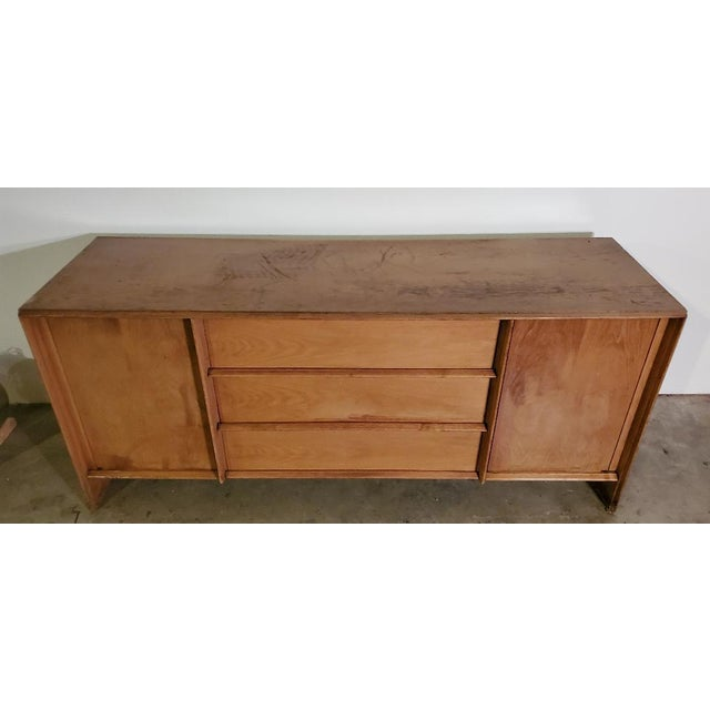 T.H. Robsjohn-Gibbings Credenza by Widdicomb. This Rare Credenza Has A Vintage Cloth Label Signed T.H. Robsjohn-Gibbings...