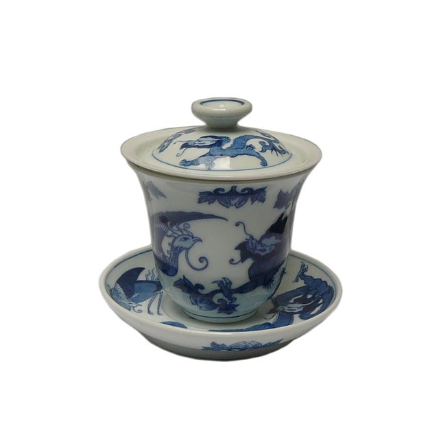 This is a handmade blue & white porcelain traditional Chinese teacup set with lid and tea leave filter. Each piece is...