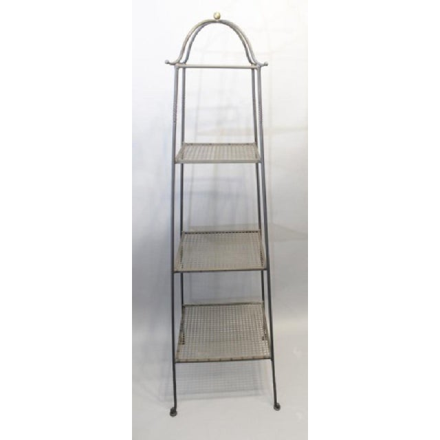 Industrial Triple-Tiered Black Wrought Iron Stand, having twist detail and curves at top.
