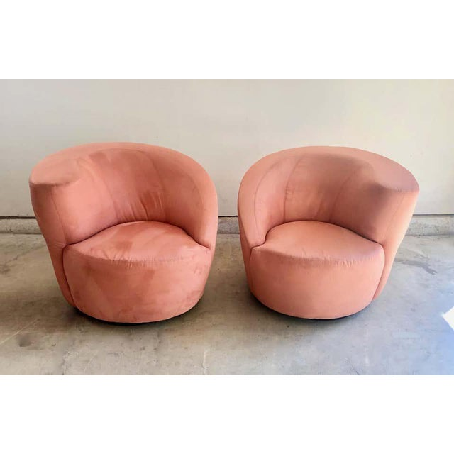 """Vladimir Kagan for Directional """"Nautilus"""" swivel chairs. The upholstery is a cantaloupe color for a great pop of color in..."""