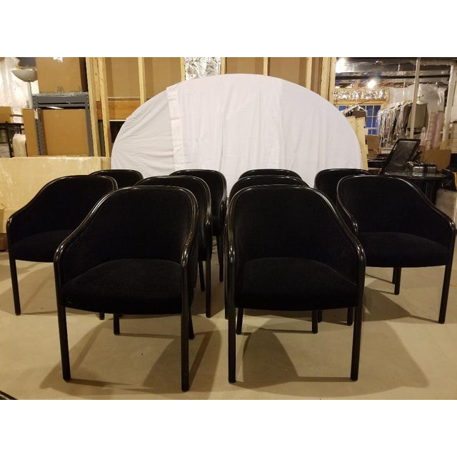 Ward Bennett for Brickel Round Carved-Wood Frame arm chairs from the mid 1980s. Elegant black lacquered walnut wood frame...