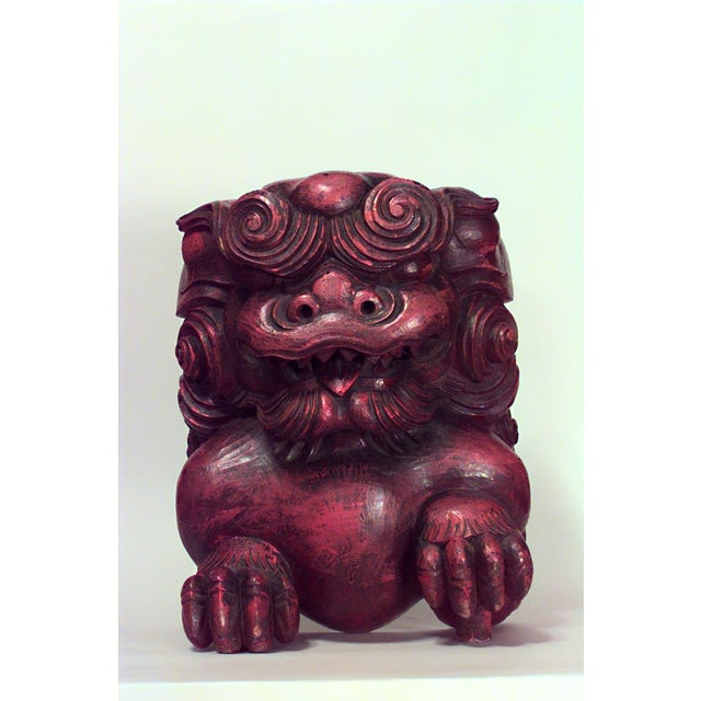 Pair of Asian Chinese style (19/20th Cent) red lacquered carved figures of squatting foo dogs