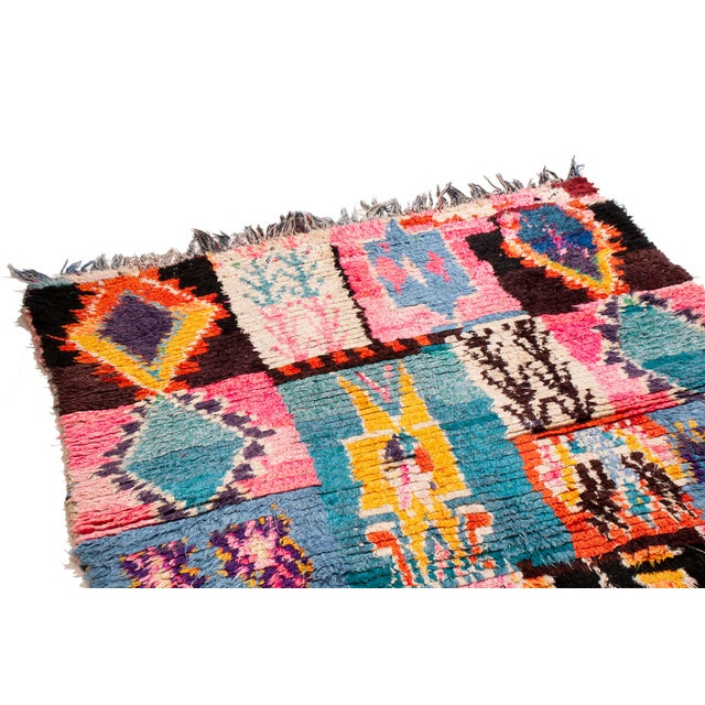 This delightful Moroccan rug is all the rage. A wonderful assortment of blue, pink, yellow and orange in a loose pattern...