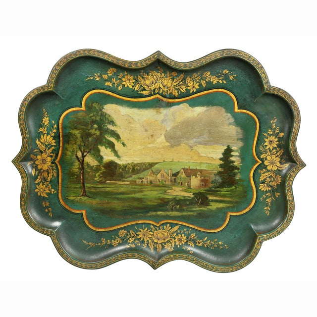 Scalloped edge with central painting of a country house with gilt stenciled borders. Bamboo turned legs. Later painted tray.