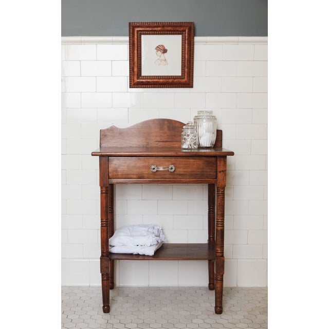 This sweet little fruitwood wash stand has farmhouse look with a touch of sophistication. The drawer has been lined with...