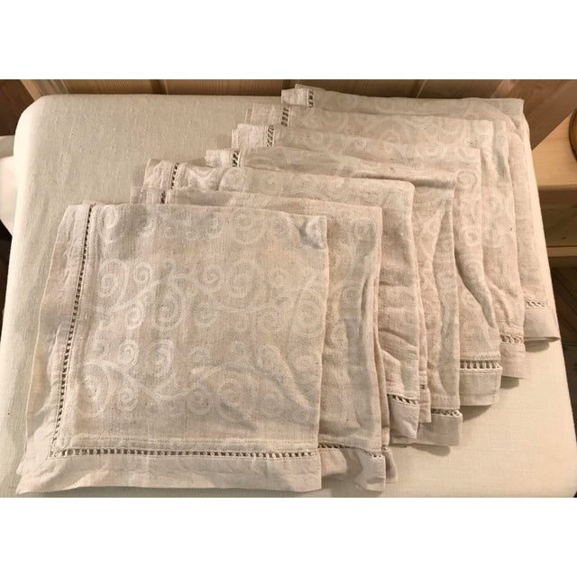 Nice set of 7 soft fabric dinner Napkins with a swirl pattern and cut work edges. Very pretty.
