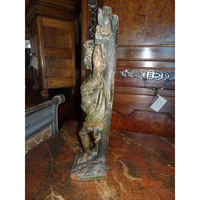 This is a unique piece. A treasure from the late 17th Century . A Carved wood representation of Christ. Original green...
