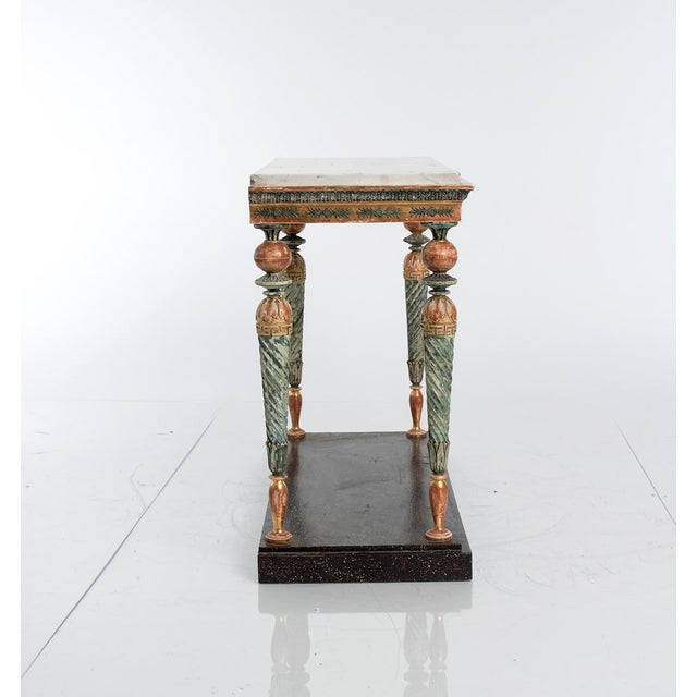 Jonas Frisk, Stockholm mirror maker, active between 1805 and 1824. A gilded console table with polychrome painted legs,...