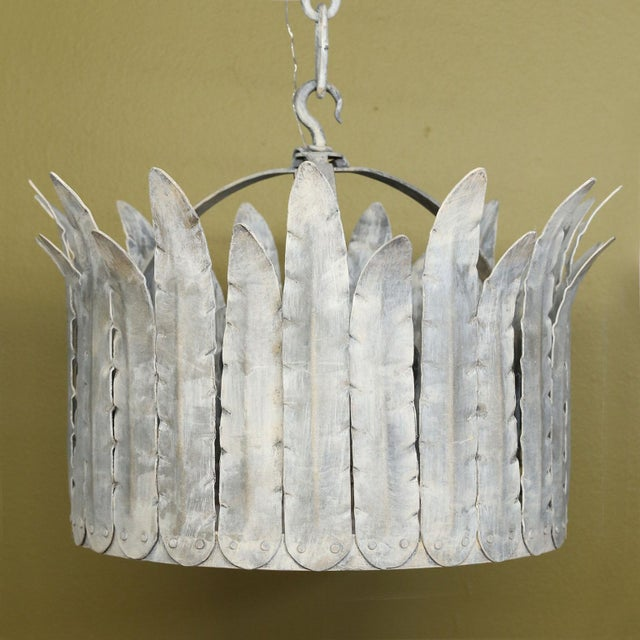 """Hand-crafted iron """"Fairfield"""" crown light is a metal light fixture with crimped-edged tole feathers in a silver finish by..."""