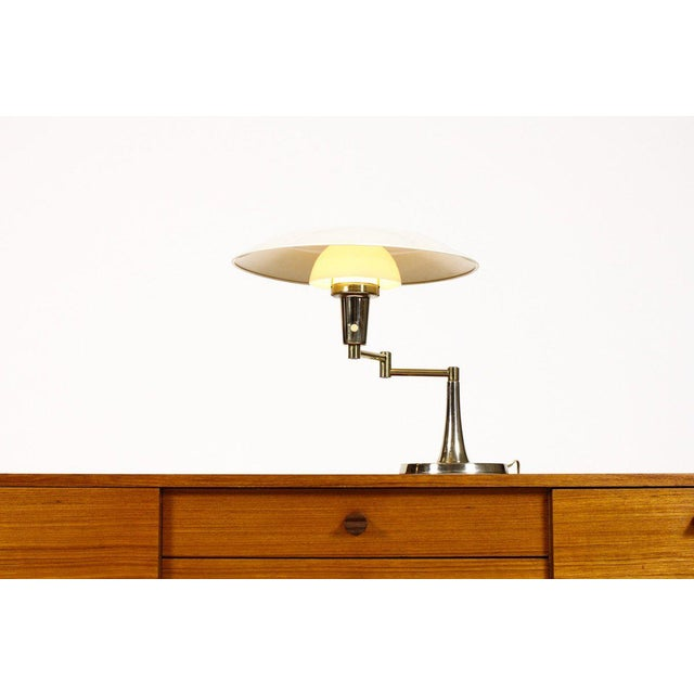 Vintage swing arm desk lamp. Brass with pearl white enamel finish. Ribbed milk glass diffuser. Unknown manufacturer, but...