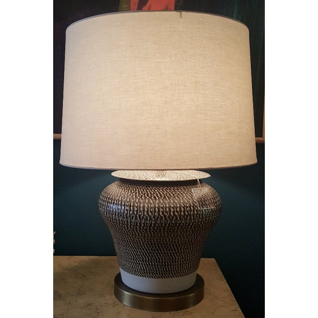 Winkworth table lamp by Currey and Company. Porcelain table lamp with cream and brown accents, metal base in antique...