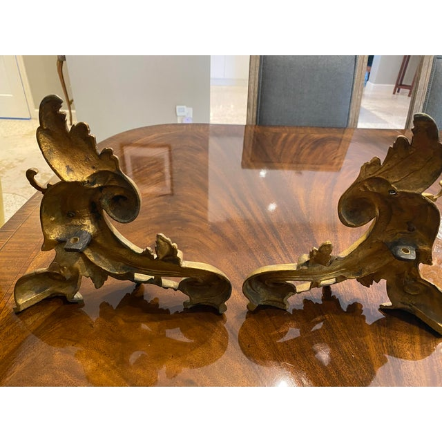 """Beautiful pair of gilt Chenets in excellent condition. They are 9.7""""H x 9.8""""W."""