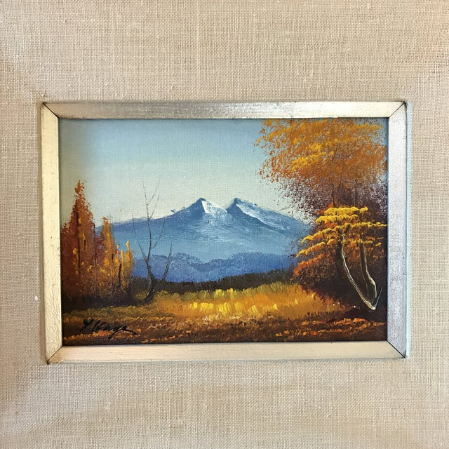 Beautiful mountain landscape paining, signed by the artist. This piece is framed, matted and ready to hang. Features...