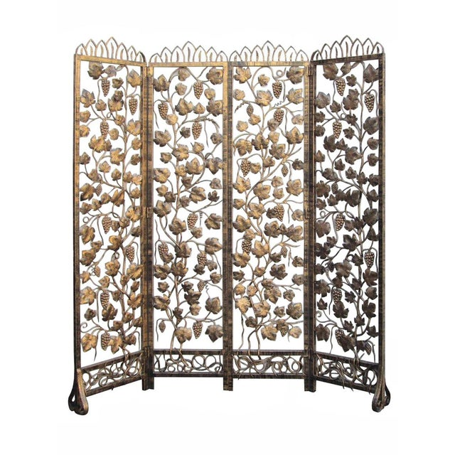 This is a very heavy piece of golden color screen. It is made of metal and has four foldable panels. The screen painted...