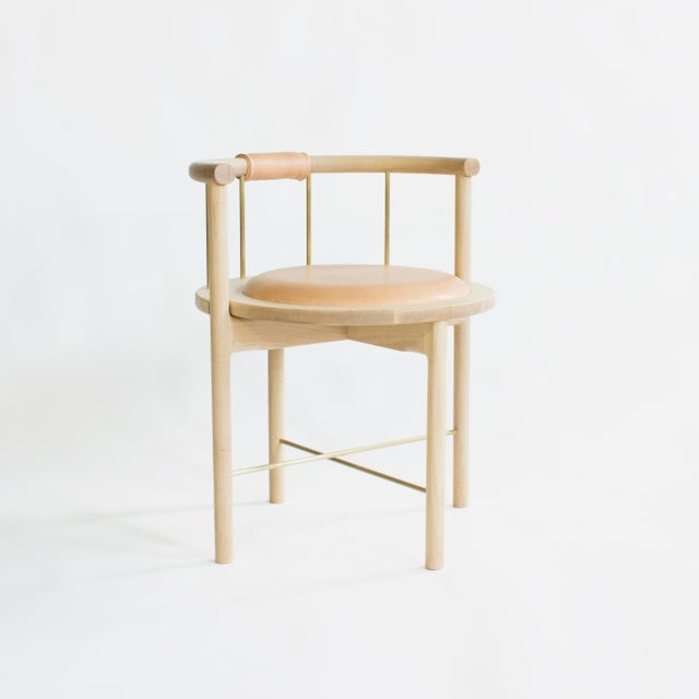 Solid wood construction / zero voc oil finished / solid metal rungs / leather wrapped back support / recessed leather seat...