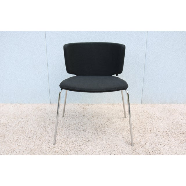 This Clean and elegant Wrapp Side/Guest Chair combine a snug winged back with generous contoured seat for Comfort and...