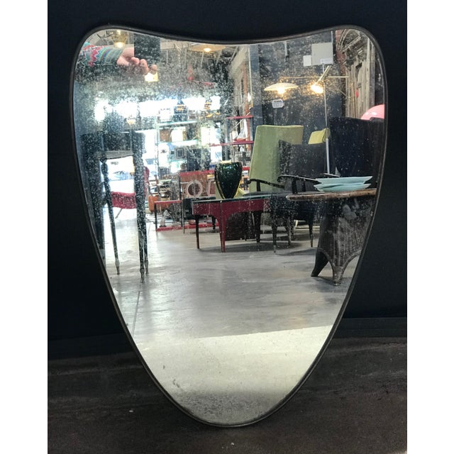 Italian minimal curvilinear brass mirror, 1950s.